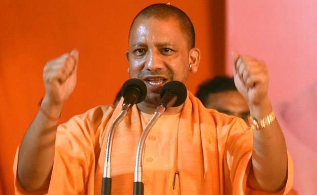 Yogi Congratulates To Prime Minister Narendra Modi - Sakshi