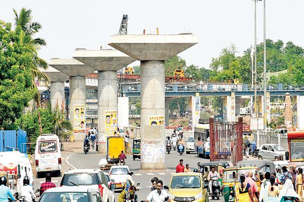 Bezawada flyover works was nill - Sakshi