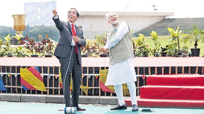 PM Narendra Modi, Indonesia President Widodo agree to take bilateral relations - Sakshi