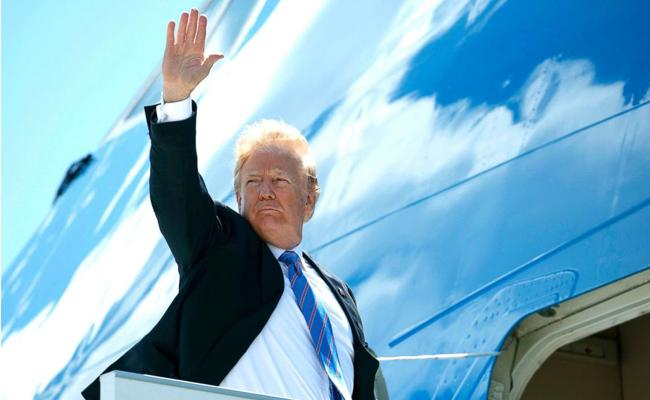 Donald Trump Also Arrives In Singapore For Meeting With Kim - Sakshi