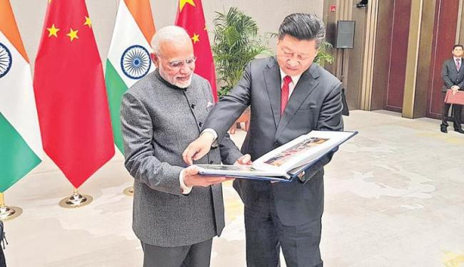 PM Modi in China for SCO Summit, to hold bilateral talks with Xi Jinping - Sakshi