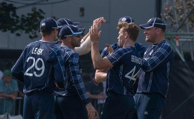 Scotland Win By 6 Runs Against England - Sakshi
