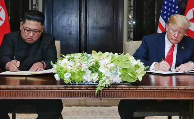 Trump And Kim Jong Un Sign On Joint Statment - Sakshi