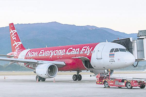 AirAsia Group denies allegations of aviation corruption by India police - Sakshi