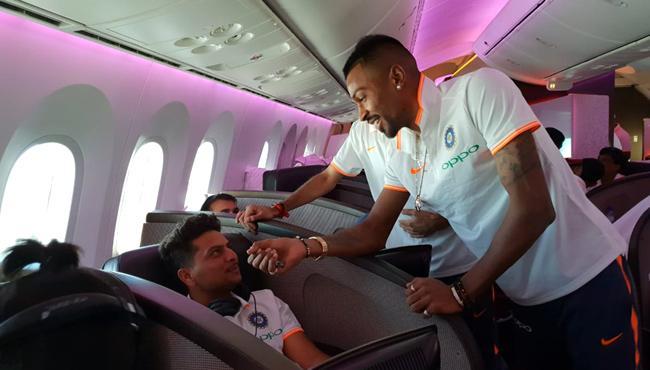 Hardik Pandya interviews Kohli, Dhoni mid-air on flight - Sakshi