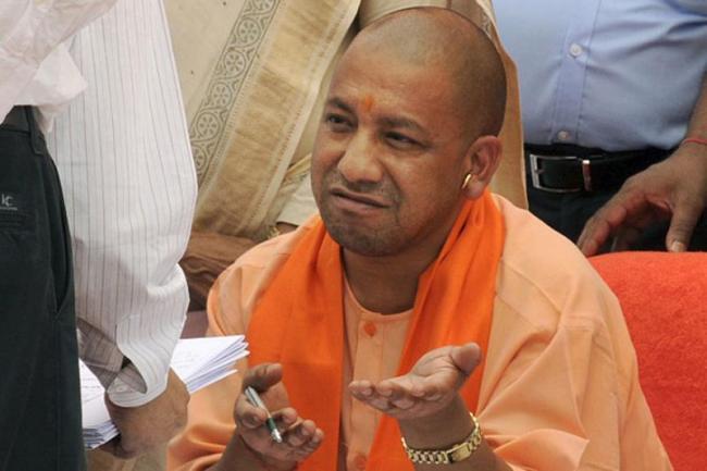 UP CM Yogi Refuse To Wear Cap At Kabir Mausoleum - Sakshi