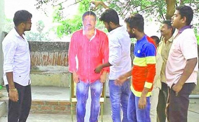 Akkineni Fans Done Palabhishekam To RGV Cutout - Sakshi