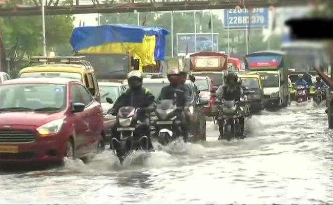Heavy Rains In Mumbai 2018 - Sakshi