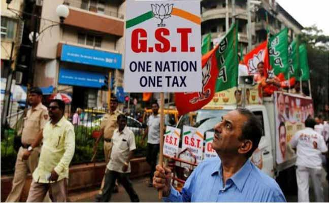 BJP And Congress Comments On GST Day - Sakshi