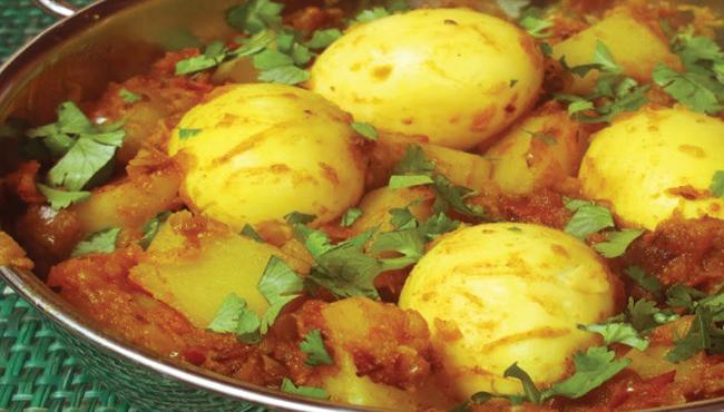 Woman shot dead for not cooking egg curry for her husband in UP - Sakshi