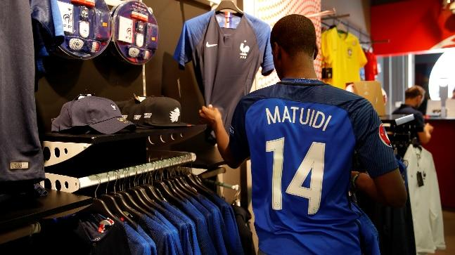 France shirts in high demand in Paris ahead of final - Sakshi