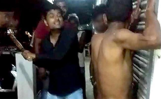 Three Tribes Stripped Nude And Beaten By Owner For Diesel In MP - Sakshi