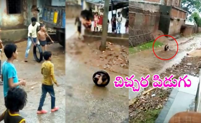 Boy Rolls Around The Street In A Tyre Viral - Sakshi