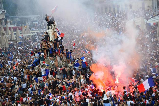 France Celebrations Marred As Two Fans Die And Cops Fire Tear Gas  - Sakshi