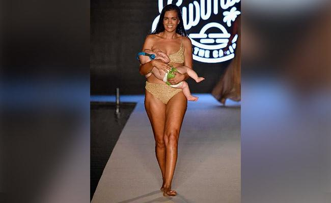 US Model Give Breastfeed To Her Baby Over Ramp Walk - Sakshi