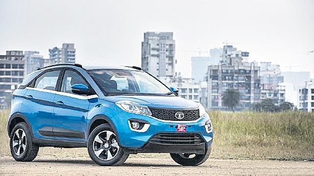 Tata Motors hikes vehicle prices - Sakshi
