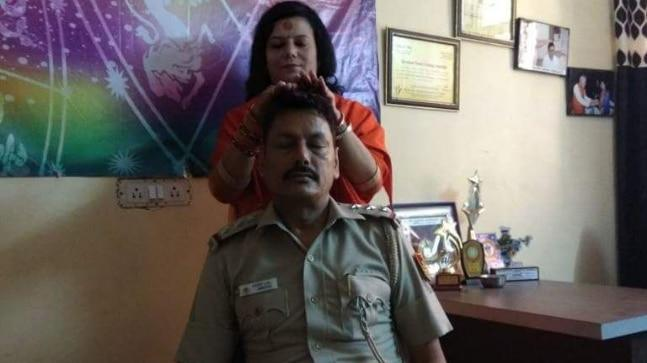 SHO Transferred After His Photo With God Woman Goes Viral In Delhi - Sakshi