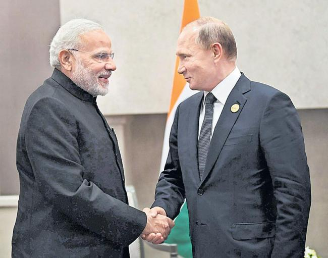 PM Modi holds bilateral talks with Putin on sidelines of BRICS summit - Sakshi