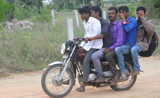 Youth Triple Riding Photo Captured In Chittoor - Sakshi