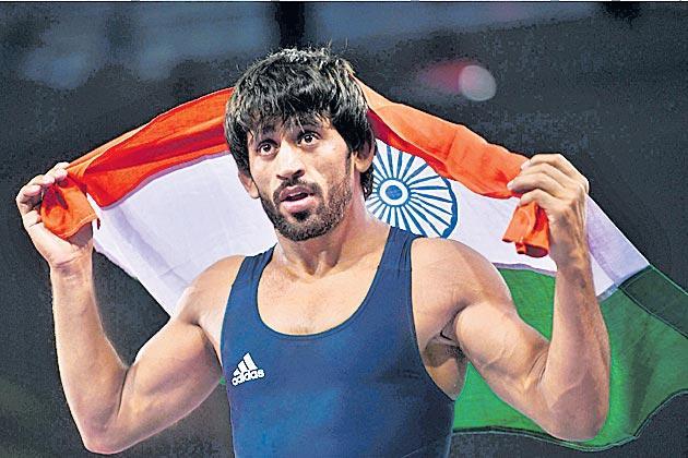 Wrestling: Bajrang Punia, Sandeep Tomar in final  - Sakshi