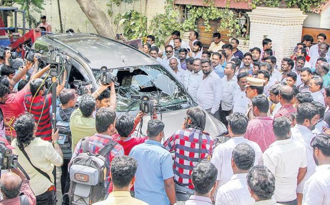 Petrol bomb hurled outside TTV Dinakaran's house - Sakshi