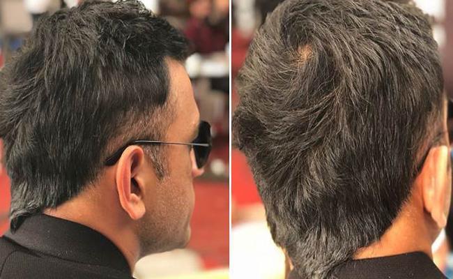 MS Dhoni sports trendy V Hawk hairstyle - Sakshi