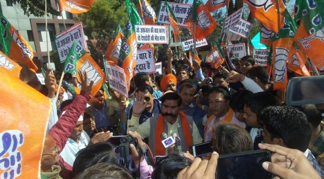 BJP MLA Gyan Dev Ahuja Says Tie Cow Smugglers To A Tree And Inform Police - Sakshi