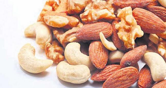 Buddy, pistachio, walnut, cashew nuts - Sakshi