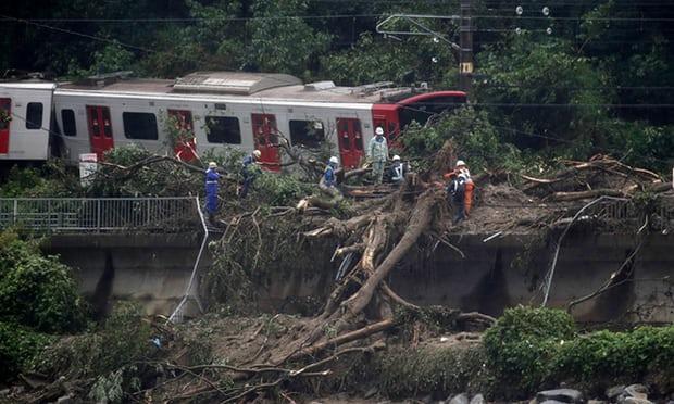 Flash Floods Landslides And Earth Quake Hits Japan - Sakshi