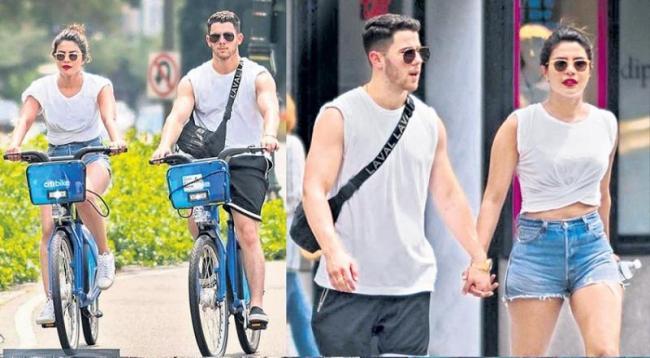 Priyanka Chopra and Nick Jonas enjoy cycling on New York streets - Sakshi