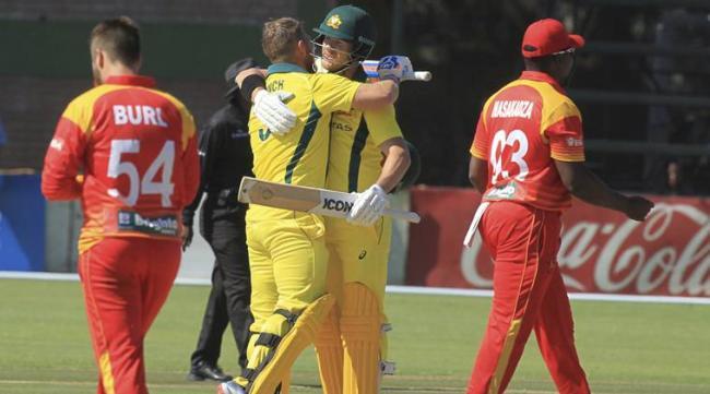 Australia beat Zimbabwe by 5 wickets - Sakshi