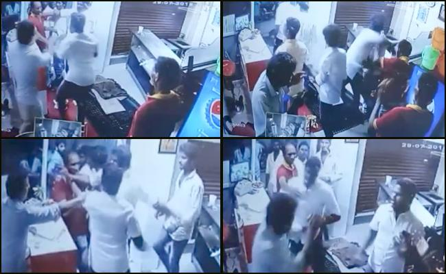DMK Workers thrashed Hotel staff in Chennai - Sakshi