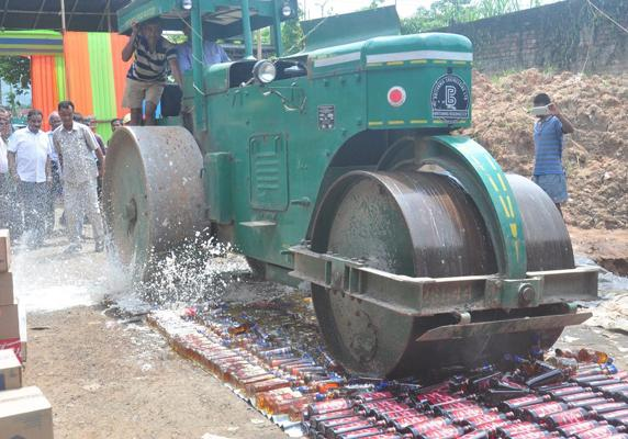 Assam government destroyes six lakh bottles of illegal liquor - Sakshi