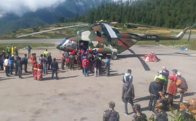 Indian Pilgrim Dies After Being Hit by Rear Blade of Helicopter - Sakshi