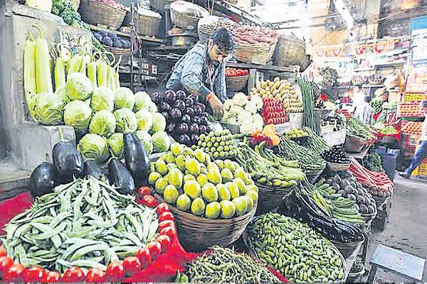WPI inflation ebbs in July after hitting 4-year high in June - Sakshi