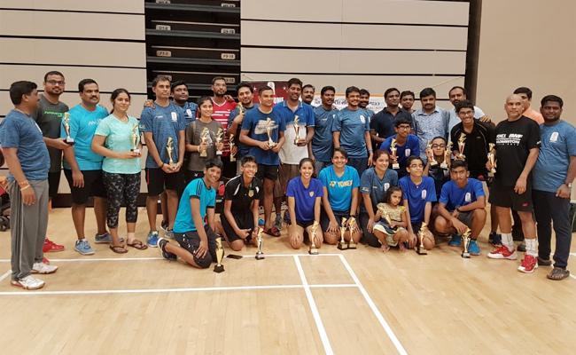 Singapore Telugu Samajam conducts Badminton Tournament - Sakshi