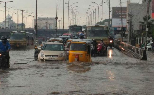 Heavy Rains Brings Chennai Standstill On Tuesday - Sakshi