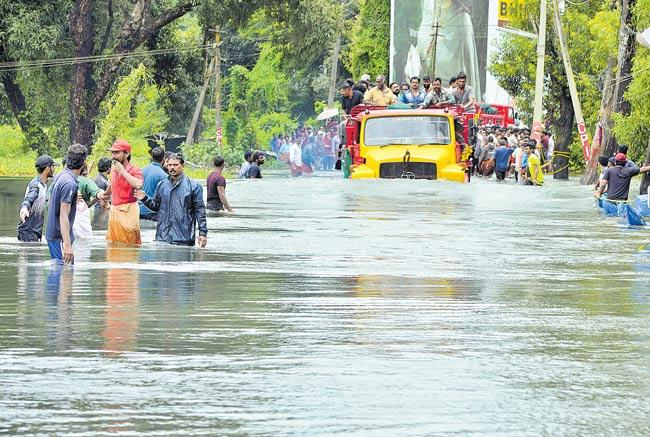 kerala floods social media postings on Flood victims - Sakshi