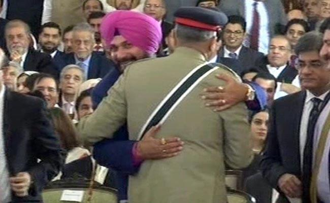 Navjot Singh Sidhu  Said My Hugging Pakistan Army Chief Should Not Be Seen In Bad Light - Sakshi