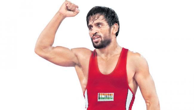 Bajrang Punia wins thrilling 65kg final to claim India first gold - Sakshi