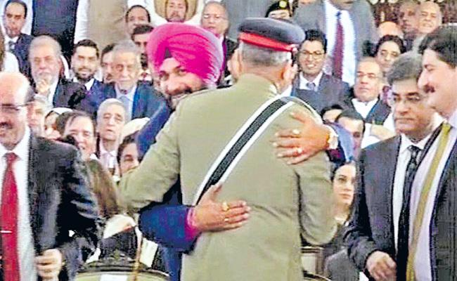Navjot Singh Sidhu Hug To Pakistan Army Chief Trolled - Sakshi