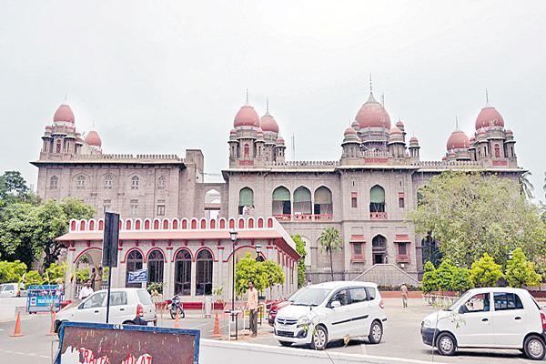 Demolition of private building by mistake of Revenue Inspector - Sakshi