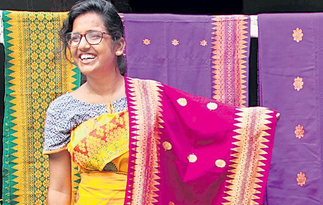 Akhila targets designed to make designs on handloom clothe - Sakshi