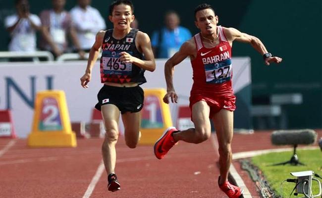 Asian Games Marathon Winner Hiroto Accused of Pushing Rival Elabbassi During race - Sakshi