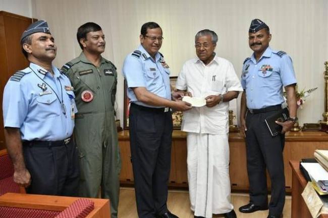 Kerala floods: Indian Air Force donates  Rs 20 crore - Sakshi
