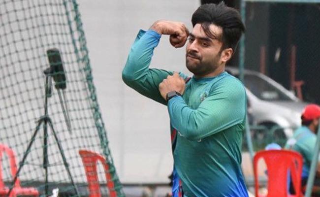 Rashid Khan accepts Virat Kohlis quirky catches challenge - Sakshi