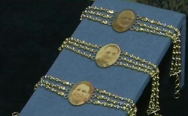 Gold Rakhis With Faces Of PM Modi And Yogi Adityanath - Sakshi