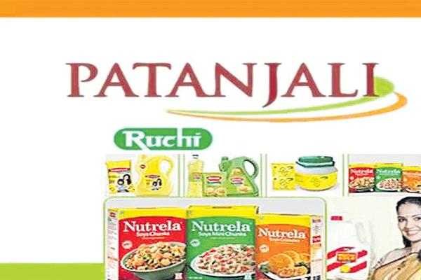 Patanjali objects to lenders decision to award Ruchi Soya to Adani Wilmar - Sakshi