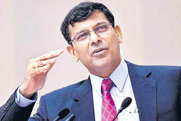 Rupee has not depreciated to a worrying level, says Raghuram Rajan - Sakshi