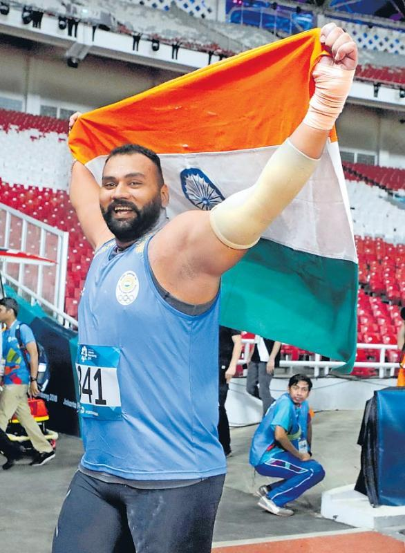 Indian Shot Put Player Tejinder Pal Singh Toor Wins Gold At Asiad 2018 - Sakshi